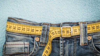 pair of jeans with a tape measure as a belt