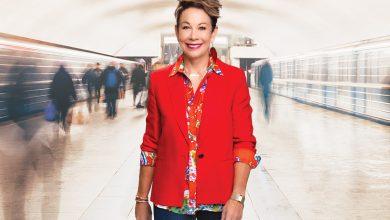 Carol walking through busy hallway