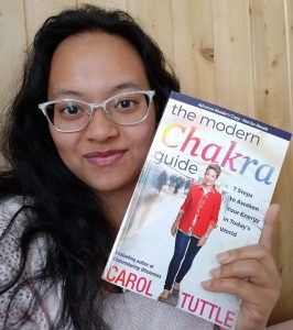 Yoshimi sharing Carol's chakra book