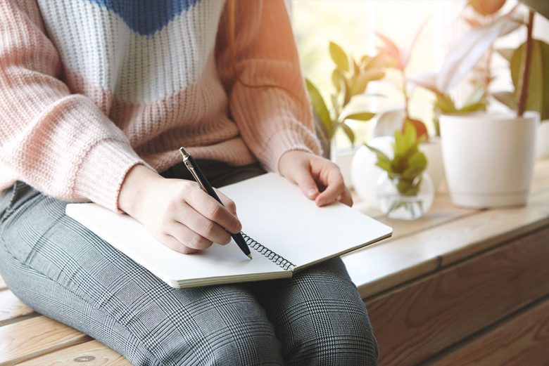 Woman journaling in a quiet space