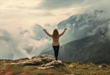 Woman looking out over mountains - how to stop self-sabotage