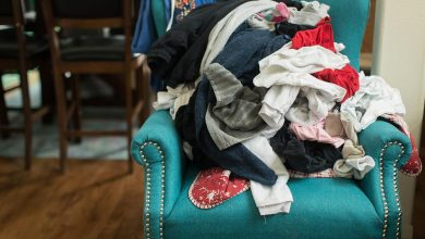 Messy clothes on green armchair